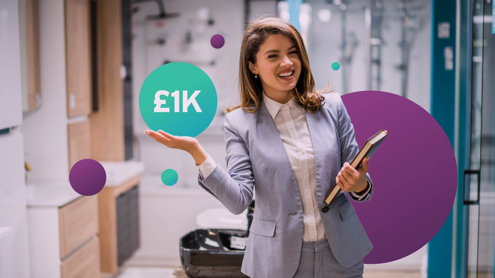 Business owner smiling while holding the £1K graphic campaign branding.