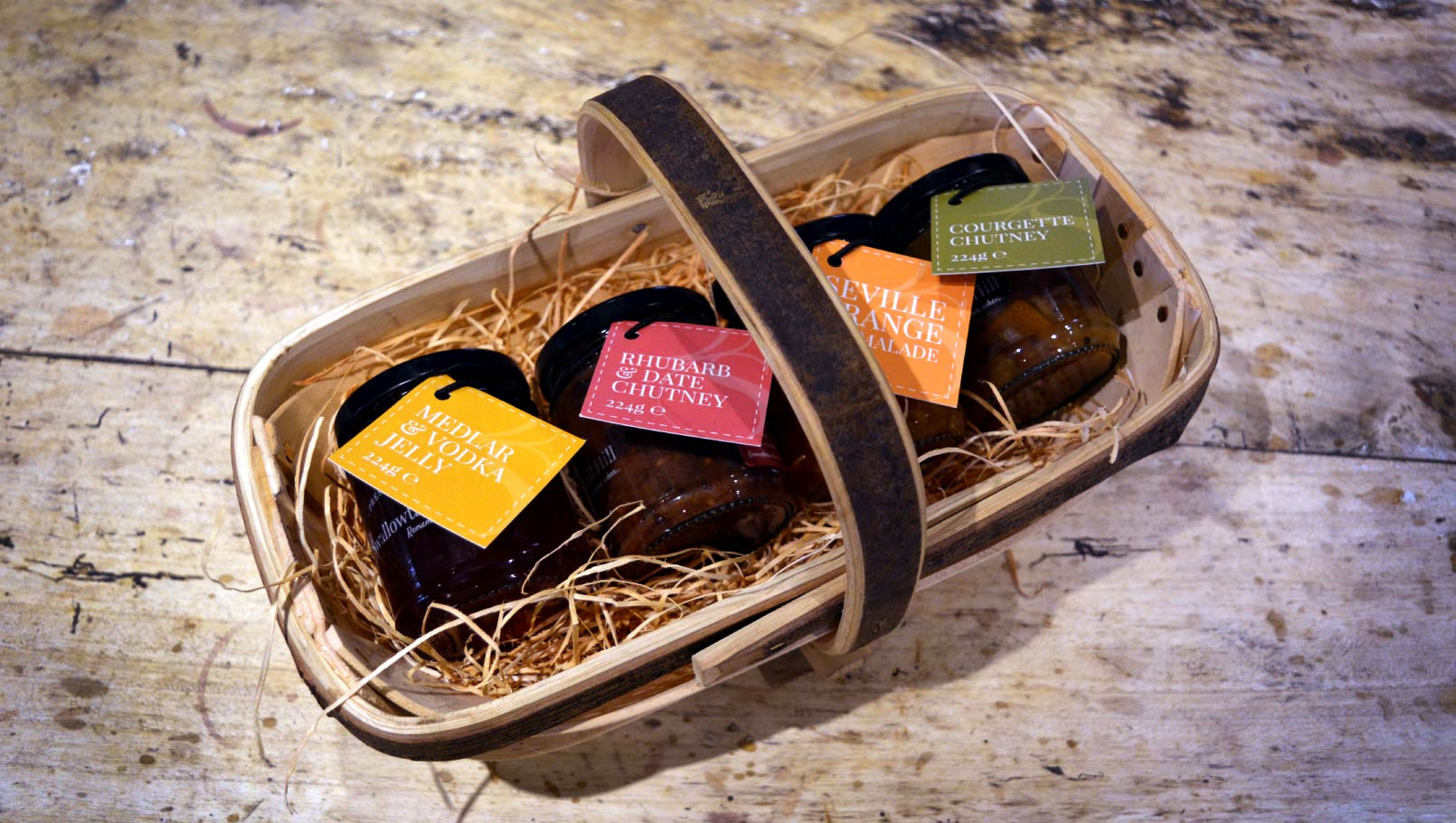 Swallowtail Hill Preserves branding and label design in basket.