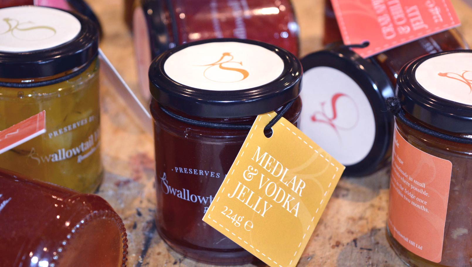 Swallowtail Hill Preserves branding and label design and lids.